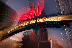 """""""Downtown Reno 4"""" - This Reno, The Biggest Little City in the World sign was photographed in Reno, Nevada at sunset. The effect was obtained in camera by long exposure mixed with intentional camera movement."""