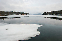Lake Winnipesaukee shows a glimpse of open water from the Governor's Island bridge on Tuesday morning.  (Karen Bobotas/for the Laconia Daily Sun)