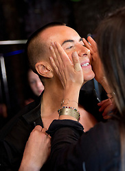 Designer Julien Macdonald gets some makeup on at the backstage during the London Fashion Week SS18 show held at No 1 Invicta Plaza, London