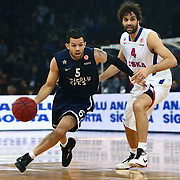 Anadolu Efes's Jordan Farmar (L) and CSKA Moscow's Milos Teodosic (R) during their Euroleague Top 16 game 8 basketball match Anadolu Efes between CSKA Moscow at the Abdi Ipekci Arena in Istanbul at Turkey on Friday, February, 22, 2013. Photo by TURKPIX