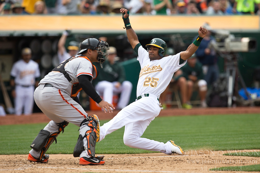 OAKLAND, CA - MAY 27: Chris Young #25 of the Oakland Athletics slides into home plate to score a run past Guillermo Quiroz #12 of the San Francisco Giants during the seventh inning of the interleague game at O.co Coliseum on May 27, 2013 in Oakland, California. (Photo by Jason O. Watson/Getty Images) *** Local Caption *** Chris Young; Guillermo Quiroz
