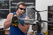 Steven Thornton cuts tubing for the University of West Florida SAE Baja Team car to compete at SAE Baja Kansas. The University of West Florida will be traveling to Pittsburg, Kansas Wednesday May 16 2018 to compete against over 99 other universities in the 4 day event. This will be the first-ever competition for the UWF SAE Team Baja: A team of Mechanical Engineering students founded in January 2017. (Michael Spooneybarger/ Division of Research and Strategic Innovation)