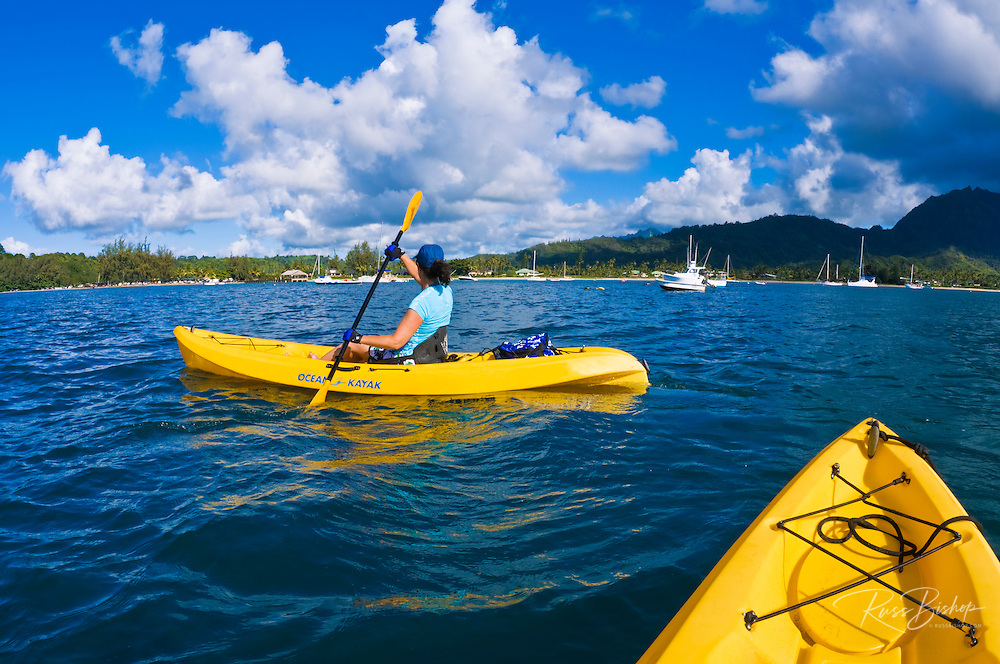 Woman kayaking on Hanalei Bay, Island of Kauai, Hawaii