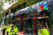 """Police guard the Standard Chartered building after XR activists covered its entrance in red paint during an Extinction Rebellion climate change protest in the city of London on Friday, 27 Aug 2021. This is their fifth day of an ongoing two-week disruption protest campaign """"The Impossible Rebellion"""". (VX Photo/ Vudi Xhymshiti)"""