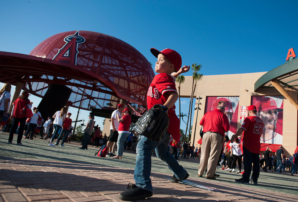 Ayden Lim, 6, of Chino Hills, pretends to pitch from the mound in front of Angel Stadium before the Angels' home opener Monday.<br /> <br /> ///ADDITIONAL INFO:   <br /> <br /> angels.0405.kjs  ---  Photo by KEVIN SULLIVAN / Orange County Register  --  4/4/16<br /> <br /> The Los Angeles Angels take on the Chicago Cubs during their 2016 home opener Monday at Angel Stadium.<br /> <br /> <br />  4/4/16
