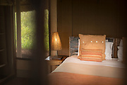 Tent interior with a bed and pillows at Olivers Camp, Tarangire National Park, Tanzania