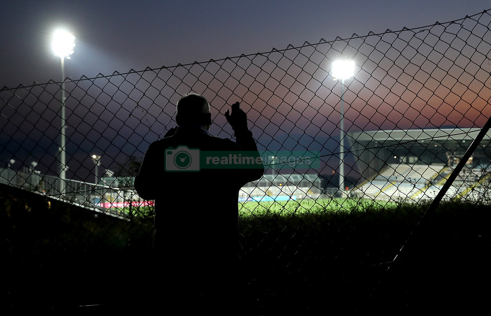 Fans at a viewpoint into the stadium before the UEFA Nations League match at Stadion HNK Rijeka in Croatia.