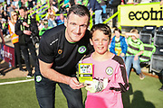 Forest Green Rovers Lee Collins(5) with FGR Ambassador during the EFL Sky Bet League 2 match between Forest Green Rovers and Milton Keynes Dons at the New Lawn, Forest Green, United Kingdom on 30 March 2019.