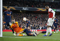 BRITAIN-LONDON-FOOTBALL-UEFA EUROPA LEAGUE-ARSENAL VS VALENCIA.(190502) -- LONDON, May 2, 2019  Arsenal's Alexandre Lacazette (1st R) has his shot stopped by Valencia's Ezequiel Garay (L) Neto (C) and Gabriel (2nd R) during the UEFA Europa League semi-final first leg match between Arsenal and Valencia at The Emirates Stadium in London, Britain on May 2, 2019. Arsenal won 3-1.  FOR EDITORIAL USE ONLY. NOT FOR SALE FOR MARKETING OR ADVERTISING CAMPAIGNS. NO USE WITH UNAUTHORIZED AUDIO, VIDEO, DATA, FIXTURE LISTS, CLUB/LEAGUE LOGOS OR ''LIVE'' SERVICES. ONLINE IN-MATCH USE LIMITED TO 45 IMAGES, NO VIDEO EMULATION. NO USE IN BETTING, GAMES OR SINGLE CLUB/LEAGUE/PLAYER PUBLICATIONS. (Credit Image: © Matthew Impey/Xinhua via ZUMA Wire)