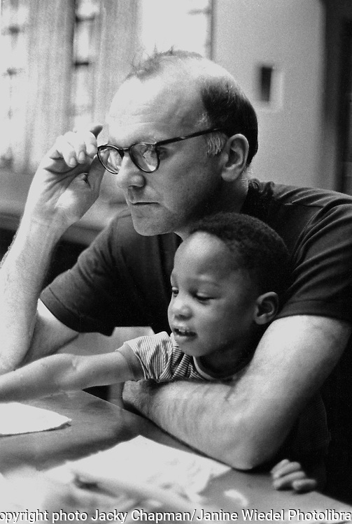 Educator and poet Ned O Gorman with young child from Harlem at his alternative school in manhattan Newb York City.