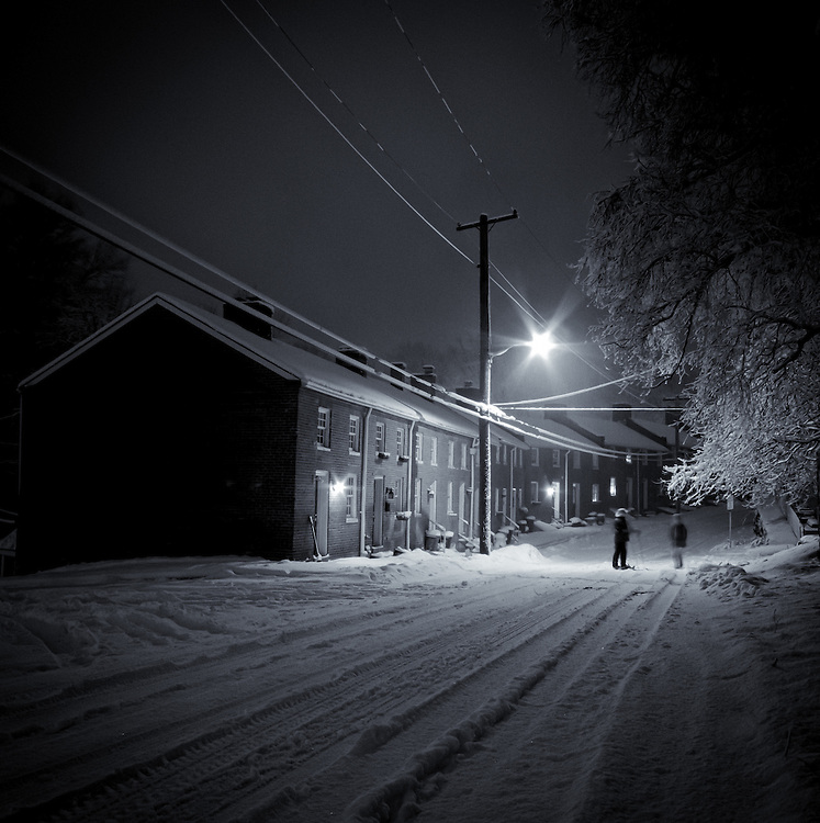 Night snow and row houses in Historic Oella, Maryland.