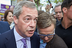 © Licensed to London News Pictures.  30/04/2015. AYLESBURY, UK. Nigel Farage (left), UKIP party leader, talks to potential voters during a campaign visit to Aylesbury. Photo credit: Cliff Hide/LNP