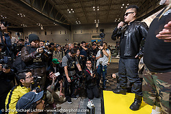 Winston Yeh of Roughcraft Customs in Taiwan says hello to the crowds and media after the grand entry of invited builders into the Mooneyes Yokohama Hot Rod & Custom Show at the Pacifico exhibition hall. Yokohama, Japan. December 3, 2016.  Photography ©2016 Michael Lichter.