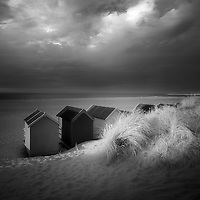 Last light on some of the beach huts at Wells-Next-The-Sea