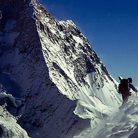 Jay Jensen in high winds on north ridge of 23,650' Mt. Baruntse, Nepal with Mt. Makalu in the Background.