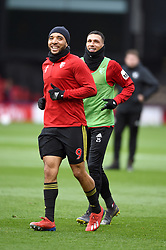 Watford's Troy Deeney (left) and Watford's Jose Holebas warm up ahead of the match
