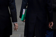 Two businessmen men stand in the street, each holding cigarettes in the heart of the capital's financial district. One man carries paperwork in his left arm while nursing his cigarette in his right, echoing that of a colleague's on the left. A recent report showed smokers each lose an average of 30 minutes a day from their workplaces to satisfy their habit. The average smoker takes at least three breaks from the office, each lasting around 10 minutes, research for the Benenden Healthcare Society found. The healthcare group estimates that 290,000 working days are being lost by people leaving their office to smoke.