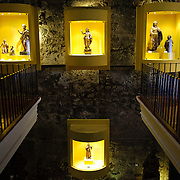 Exhibit space of religious artefacts at the museum at Casa Santo Domingo, a hotel complex built amongst the ruins of a former monastery. Famous for its well-preserved Spanish baroque architecture as well as a number of ruins from earthquakes, Antigua Guatemala is a UNESCO World Heritage Site and former capital of Guatemala.