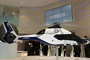 A scale model of the Airbus H160 helicopter and Airbus employees in the company's hospitality chalet at the Farnborough Airshow, on 18th July 2018, in Farnborough, England. The Airbus Helicopters H160 (formerly X4) is a medium utility helicopter being developed by Airbus Helicopters.
