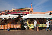 Market stalls selling dried fruit Marrakech, Morocco