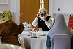 © Licensed to London News Pictures. 07/04/2021. London, UK. Camilla, Duchess of Cornwall, wearing a headscarf, puts a protective face covering during a visit to the London Islamic Cultural Society and Mosque (also known as Wightman Road Mosque) in Haringey, north London. The Mosque was formed by a small group of Guyanese Muslims and now supports over 30 different nationalities and community in Haringey and surrounding boroughs. Photo credit: Dinendra Haria/LNP