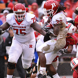 Sep 26, 2009; College Park, MD, USA; Rutgers running back Jourdan Brooks (39) is tackled during the first half of Rutgers' 34-13 victory over Maryland in NCAA college football at Byrd Stadium.