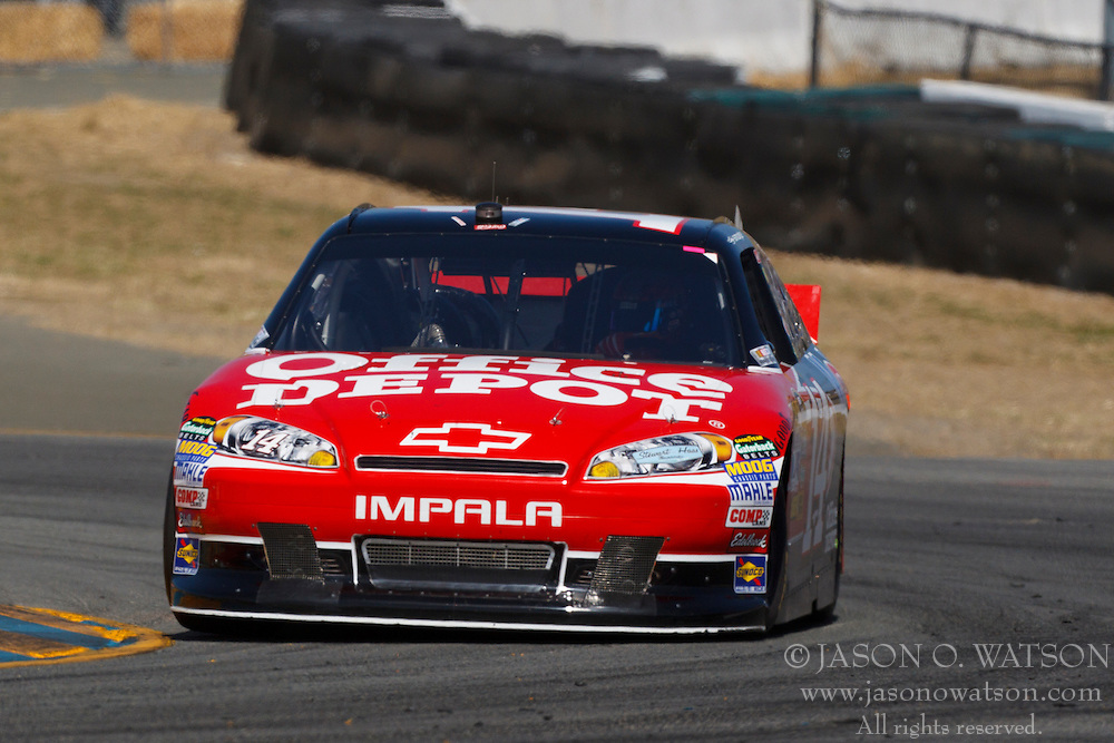June 25, 2011; Sonoma, CA, USA;  NASCAR Sprint Cup Series driver Tony Stewart (14) drives through turn 7 during practice for the Toyota/Save Mart 350 at Infineon Raceway.