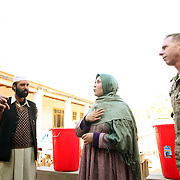 A translator (Sahar ) speaks to the principal of the Women's school and LTC Dan Wilson of the 2-27 before a water filtration demonstration in the village of Nari, Kunar Province of Eastern Afghanistan with Waves For Water and the US Military.