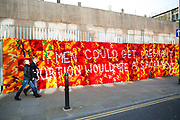 Anti abortion street art slogan sewn in to a knitted woven hanging on Brick Lane in East London. The textile artwork reads: 'If men could get pregnant abortion would bea sacrament'.