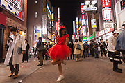 A young Japanese woman dressed as a sexy Elmo enjoys the Halloween celebrations in Shibuya. Saturday October 28th 2017
