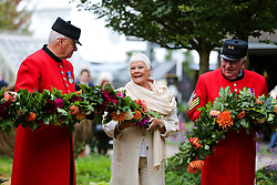 © Licensed to London News Pictures. 20/09/2021. London, UK. Dame Judi Dench (C) with Chelsea pensioners in The RHS Queen's Green Canopy Garden during press day for the RHS Chelsea Flower Show. The RHS Chelsea Flower Show is a garden show held by the Royal Horticultural Society in the grounds of the Royal Hospital Chelsea. It has been held since 1912 and this year the show will be spread over six days instead of five (from 21 to 26 September), with reduced numbers of visitors on each of the days. The annual flower show was postponed in May due to the coronavirus lockdown. Photo credit: London News Pictures