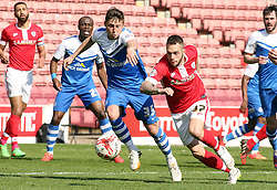 Peterborough United's Harry Beautyman in action with Barnsley's Milan Lalkovic - Photo mandatory by-line: Joe Dent/JMP - Mobile: 07966 386802 - 18/04/2015 - SPORT - Football - Barnsley - Oakwell - Barnsley v Peterborough United - Sky Bet League One