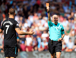 Referee Lee Mason shows a red card to West Ham United's Marko Arnautovic during the Premier League match at St Mary's, Southampton.