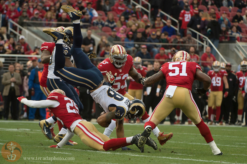 January 3, 2016; Santa Clara, CA, USA; St. Louis Rams tight end Lance Kendricks (88) is tackled by San Francisco 49ers strong safety Jimmie Ward (25) during the first quarter at Levi's Stadium.