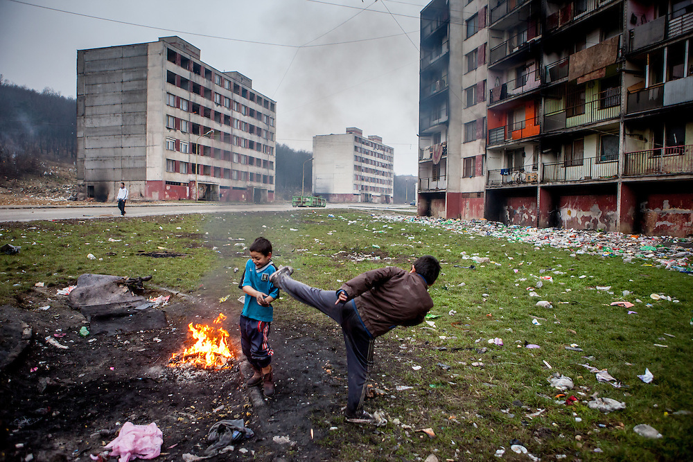 Children playing beside a fire in between highrise buildings at Lunik IX housing complex which is populated with almost 100% Roma inhabitans and located in the western-central part of the city of Kosice located in eastern Slovakia. The living conditions in Lunik IX are partly very bad and many people do not have electricity, water or gas. Some of the buildings are completely devasted. Lunik IX has officially 6542 registered (12/2015) inhabitants and almost all of them are of Roma ethnicity.