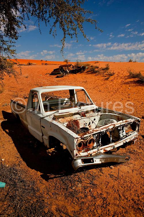 Wrecked car in the Kalahari desert near the Kagalagadi Transfrontier Park.