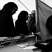 A group of women queue to register for food inside the food distribution point camp in Dagahaley refugee camp in the Dadaab, in northeastern Kenya. Hundreds of thousands of refugees are fleeing lands in Somalia due to severe drought and arriving in what has become the world's largest refugee camp. Photo: Sanjit Das/Panos