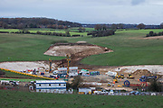 HS2 contractors work at the site of a ventilation shaft for the Chiltern Tunnel section of the HS2 high-speed rail link on 25th November 2020 in Chalfont St Giles, United Kingdom. The works, off Bottom House Farm Lane, include the construction of a temporary haul road and an embankment as well as the ventilation shaft.