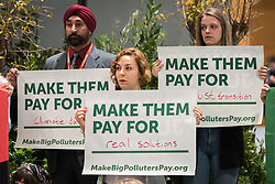 4 December 2019, Madrid, Spain: People gather for a demonstration at COP25 in Madrid, under the slogan of 'Make Them Pay', urging that the big polluters of the world cease to pollute, while helping to finance efforts for climate justice.