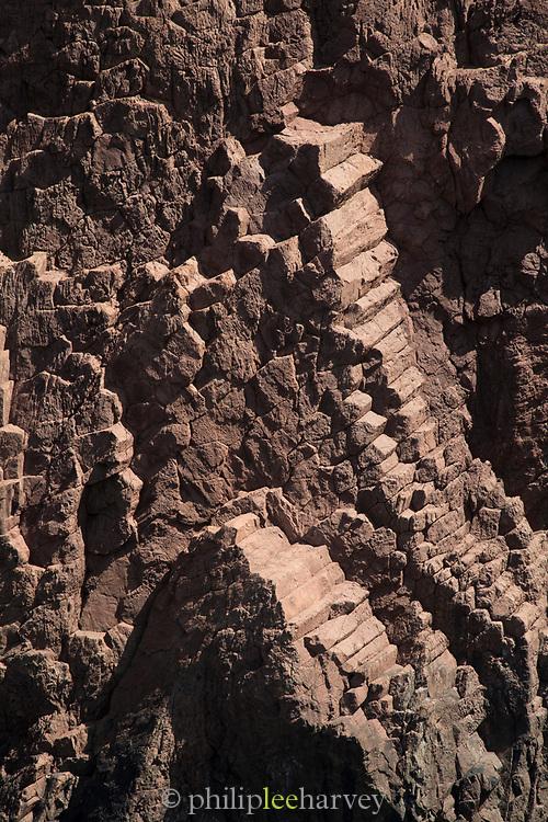 Detail of stair-like rock formation on coastline, Scandola Nature Reserve, Corsica, France