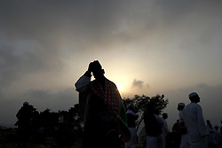28.06.2015, Nablus, PSE, Samaritaner am Berg Garizim, im Bild Betende Samaritaner am Berg Garizim // Members of the Samaritan sect pray atop Mount Gerizim near the West Bank city of Nablus after sunrise on 28 June 2015, as they celebrate the Shavuot festival, marking the giving of the Torah at Mount Sinai seven weeks after the exodus of the Jewish people from Egypt. The Samaritan religion descended from the ancient Israelite tribes of Menashe and Efraim and the community numbers today less than 700 people, half of who live on Mount Grizim in the West Bank and the other half in Holon, next to Tel Aviv, Israel. Samaritans recite prayers in ancient Hebrew using a Torah scoll. Photo by Ahmad Talat, Palestine on 2015/06/28. EXPA Pictures © 2015, PhotoCredit: EXPA/ APAimages/ Ahmad Talat<br /> <br /> *****ATTENTION - for AUT, GER, SUI, ITA, POL, CRO, SRB only*****