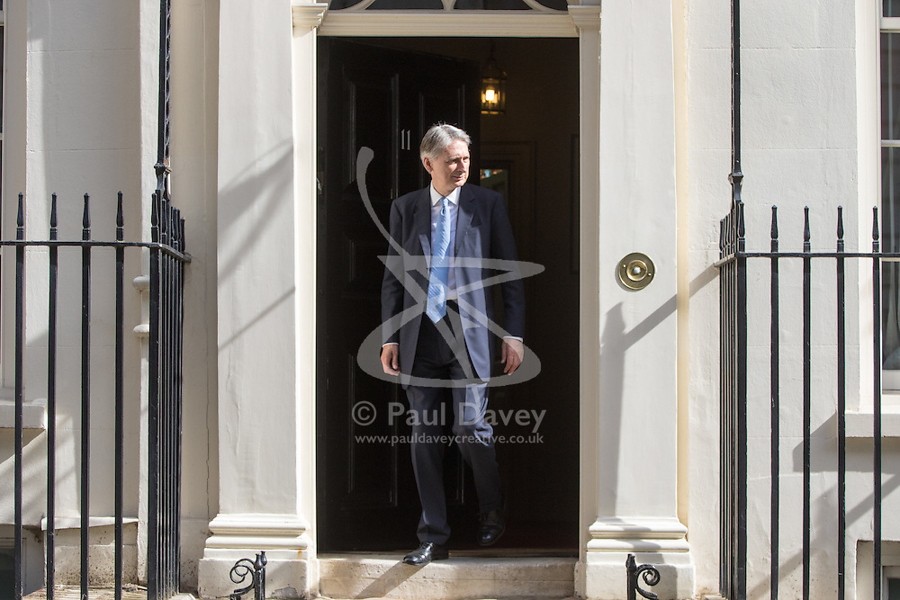 Downing Street, London, July 18th 2016. Chancellor of the Exchequer Philip Hammond welcomes CEO of Soft Bank Masayoshi Son to no 11 Downing Street as Japan's Soft Bank takes over the company in a £24 billion deal.