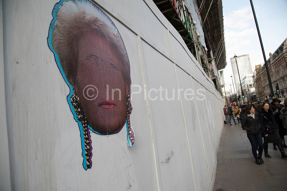 Paste up street art of the head, but not face of Pat Butcher from the television soap opera Eastenders on a hoarding in central London, England, United Kingdom.