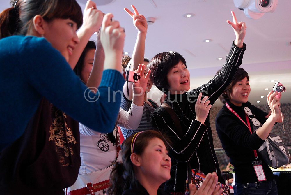 Mothers and female relatives cheer on young girls performing on the small runway at the new Barbie flagship store in Shanghai, China on 04 April, 2009. The six story store was opened in March this year to mark the 50th birthday of Barbie. The Barbie store has become a hit in Shanghai as a place where doting mothers take their daughters, often the only child in the family, for a girls' day out..