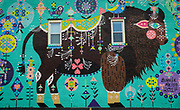 """SHOT 10/23/17 11:22:57 AM - Los Angeles artist Bunnie Reiss' mural entitled """"Magic Buffalo"""" painted on the side of Joe's Deli on Hertel Avenue in Buffalo, N.Y. The murals are part of the Albright-Knox Art Gallery's  #AKPublicArt initiative, which was made possible thanks to underwriting by the New Era Cap Foundation, with support from the City of Buffalo, Councilmember Joel Feroleto, and Joe's Deli Buffalo NY. Buffalo, N.Y. is the second most populous city in the state of New York and is located in Western New York on the eastern shores of Lake Erie and at the head of the Niagara River. By 1900, Buffalo was the 8th largest city in the country, and went on to become a major railroad hub, the largest grain-milling center in the country and the home of the largest steel-making operation in the world. The latter part of the 20th Century saw a reversal of fortunes: by the year 1990 the city had fallen back below its 1900 population levels. (Photo by Marc Piscotty / © 2017)"""