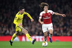 FC BATE Borisov's Nemanja Milic (left) and Arsenal's Matteo Guendouzi during the UEFA Europa League round of 32 second leg match at the Emirates Stadium, London.