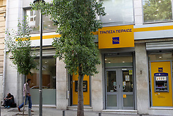 October 4, 2018 - Athens, Greece - Piraeus bank branch in Athens. Greek banking shares are down sharply amid investor fears over the lenders' needs to reduce their large stock of bad loans resulting from the financial crisis. The index of bank stocks was down 10 percent in Athens on Wednesday amid reports that some of the bigger banks plan to more aggressively write off bad loans. (Credit Image: © Aristidis VafeiadakisZUMA Wire)
