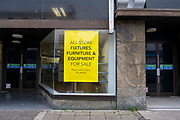A yellow all store fixtures, furniture and equipment for sale sign outside the Folkestone Debenhams store in the final few days of the 'Everything Must Go' sale before closing down on 13th Jauary 2020 in Folkestone, Kent. United Kingdom. The company announced the closure of 19 stores across the UK after going into administration in 2019.