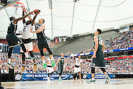 29 MAR 2015: Branden Dawson (22) and Gavin Schilling (34) of Michigan State University block a shot by Mangok Mathiang (12) of the University of Louisville during the 2015 NCAA Men's Basketball Tournament held at the Carrier Dome in Syracuse, NY. Michigan State defeated Louisville 76-70 to advance. Brett Wilhelm/NCAA Photos