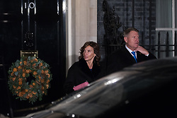 London, UK. 3 December, 2019. Klaus Iohannis, President of Romania, leaves with his wife Carmen Iohannis following a reception for NATO leaders at 10 Downing Street on the eve of the military alliance's 70th anniversary summit at a luxury hotel near Watford.